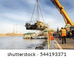 Small photo of MOSCOW, RUSSIA - NOVEMBER 11, 2016: State Unitary Enterprise Mosvodostok performs recovery vessels on coastal winter parking. River vessel carries a crane.