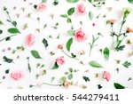 Stock photo floral pattern made of pink and beige roses green leaves branches on white background flat lay 544279411