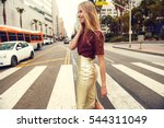 fashionable blonde woman in red ... | Shutterstock . vector #544311049