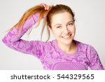 Young Smiling Woman Straighten...
