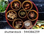 Small photo of thai northern style food set, including curry, chilli dip, larb moo, cab moo and sticky rice