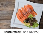 Slices Of Smoked Salmon On A...