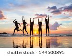group of people jumping on the... | Shutterstock . vector #544500895