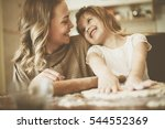 mother and daughter baking... | Shutterstock . vector #544552369