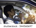 man driving car with beer in... | Shutterstock . vector #544560697