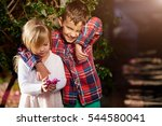 two happy children playing near ...   Shutterstock . vector #544580041