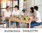 chinese family having lunch | Shutterstock . vector #544625794