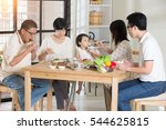 chinese family having lunch | Shutterstock . vector #544625815