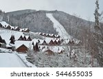 Wooden Snow Covered Chalet In...