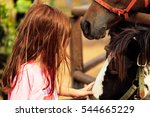 a cute white girl touches the... | Shutterstock . vector #544665229