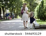 rear view of young mother...   Shutterstock . vector #544693129