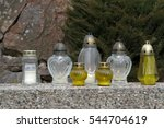 Small photo of Votive candles lantern. All Saints' Day decoration. Solemnity of All Saints.