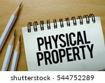 Small photo of Physical Property text written on a notebook with pencils