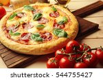 homemade pepperoni pizza on... | Shutterstock . vector #544755427