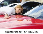 happy woman loves her  new sports car - stock photo
