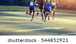 marathon runners running on... | Shutterstock . vector #544852921