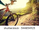 riding mountain bike at sunrise ...   Shutterstock . vector #544854925