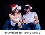 Happy Couple In Santa Hats...