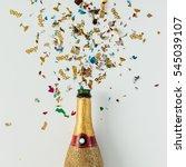 golden champagne party bottle... | Shutterstock . vector #545039107