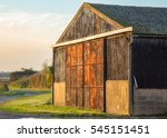 Small photo of Barn on farmland near the village of Abridge in Essex, England on a bright autumn day. Has lovely golden light.