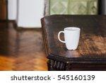 white mug on wooden brown table....   Shutterstock . vector #545160139