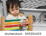 cute asian girl playing with an ... | Shutterstock . vector #545201425