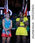 Small photo of MELBOURNE, AUSTRALIA - JANUARY 30, 2016:Grand Slam champion Angelique Kerber of Germany (L) and Australian Open 2016 finalist Serena Williams during trophy presentation after final match in Melbourne