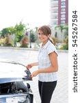 woman opens bonnet  | Shutterstock . vector #545267584