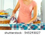 closeup of woman ironing... | Shutterstock . vector #545293027