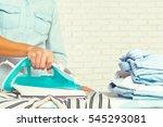 closeup of woman ironing... | Shutterstock . vector #545293081