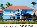 Bright Colors. Blue House Near...