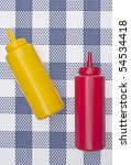 Summer Picnic Concept with Bottles of Ketchup and Mustard. - stock photo