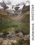 Small photo of HUMANTAY LAKE, PERU - OCTOBER 15, 2016: Humantay glacial lake, at 4,200 metres or 13,779 ft, is a three-hour round trek from Soraypampa. The mountain of Humantay is part of the Vilcabamba Range.