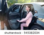 businesswoman in luxury car | Shutterstock . vector #545382034