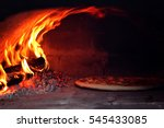 pizza in pizza oven heated by... | Shutterstock . vector #545433085