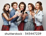 Group Of Young Women Looking A...