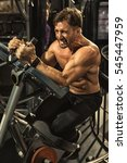 Small photo of Abs burning! Vertical portrait of a mature fitness man with strong muscular toned body performing abs workout on ab coaster machine at the gym