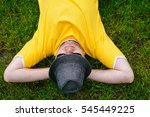 Man In Yellow T Shirt And Hat...