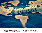 Small photo of BELIEF on grunge world map
