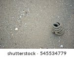 Small photo of lugworm or sand worm casts on the beach