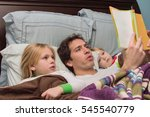 father reading daughter and son ... | Shutterstock . vector #545540779