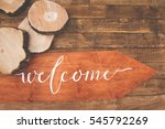 inscription welcome on a wooden ... | Shutterstock . vector #545792269