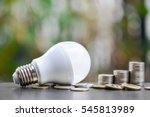 led bulb and coin stack  ... | Shutterstock . vector #545813989