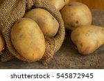 Close Up Potatoes In Sack On...