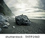 Man Sitting On A Big Rock On A...