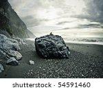 Man Sitting On A Big Rock On A...