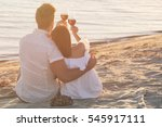 young couple with wine having... | Shutterstock . vector #545917111