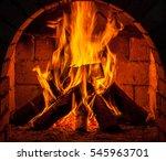 a fire burns in a fireplace. | Shutterstock . vector #545963701