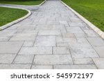 stone walkway in the park.... | Shutterstock . vector #545972197