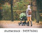 young mother pushing stroller...   Shutterstock . vector #545976361